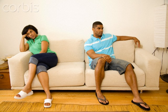 Couple ignoring each other --- Image by © Big Cheese Photo/Corbis